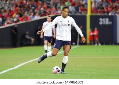 NEW YORK - JULY 24, 2019: Center-back Virgil van Dijk of Liverpool FC (4) in action against Sporting CP in the 2019 Western Union Cup game at Yankees stadium in New York