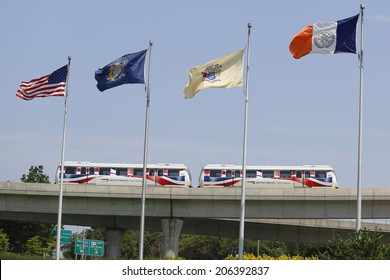 NEW YORK - JULY 8: JFK Airport AirTrain in New York on July 8, 2014. AirTrain JFK is a 3-line, 8.1 miles long elevated railway providing service to Kennedy International Airport