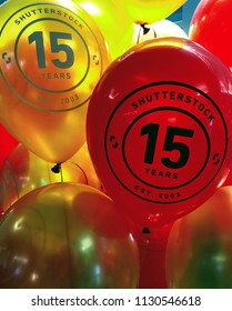 """NEW YORK, July 9, 2018 -- """"Shutterstock / 15 Years / Est. 2003"""" on red and yellow balloons in the Empire State Building in celebration of the 15th anniversary of Shutterstock, Inc. (NYSE: SSTK)."""