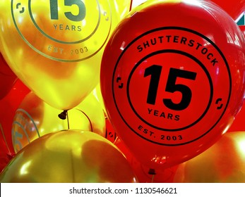 "NEW YORK, July 9, 2018 -- ""Shutterstock / 15 Years / Est. 2003"" on red and yellow balloons in the Empire State Building in celebration of the 15th anniversary of Shutterstock, Inc. (NYSE: SSTK)."