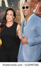 """NEW YORK - JUN 10: Actor Dwayne Johnson (R) and  executive producer Dany Garcia attend the premiere of """"Skyscraper"""" at AMC Loews Lincoln Square on June 10, 2018 in New York City."""