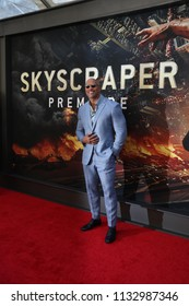 "NEW YORK - JUN 10: Actor Dwayne Johnson attends the premiere of ""Skyscraper"" at AMC Loews Lincoln Square on June 10, 2018 in New York City."