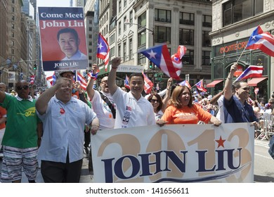 NEW YORK - JUNE 09: Democratic candidate for mayor of New York John Liu attends the National Puerto Rican Day Parade in Manhattan on June 09, 2013 in New York City