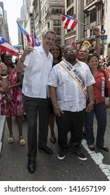NEW YORK - JUNE 09: Governor of Puerto Rico Alejandro Garcia, George Gresham of 1199 SEIU attend the National Puerto Rican Day Parade in Manhattan on June 09, 2013 in New York City