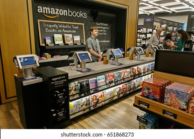 New York, June 1, 2017: Clerk stand behind the checkout counter in a newly opened Amazon Books store in Time Warner Center.