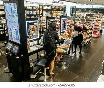 New York, June 1, 2017: Female customers of Sephora are having makeup applied to their faces by the store's stylists.