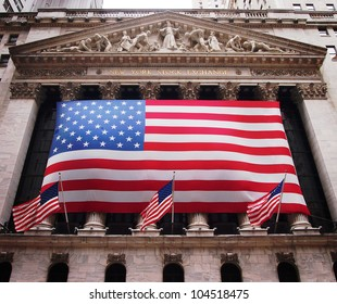 NEW YORK, JUNE 1: An American flag hangs on the front of the New York Stock Exchange building in New York City, June 1, 2012.