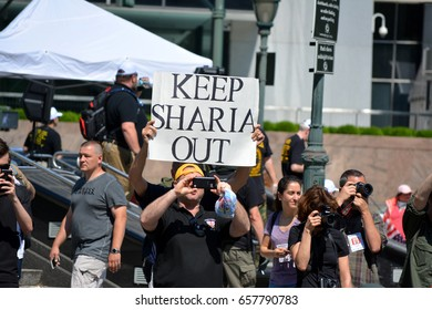New York, New York. - June 10, 2017: People carrying signs at a rally against Sharia in Manhattan in 2017.