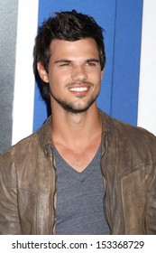 """NEW YORK - JUNE 10: Taylor Lautner attends the premiere of """"Grown Ups 2"""" at AMC Lincoln Square on June 10, 2013 in New York City."""
