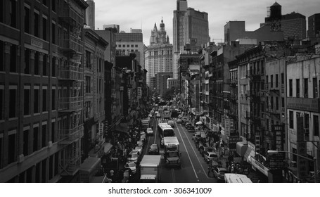 NEW YORK - JUNE 11: Loose traffic and crowds of people flow through Chinatown in Manhattan, as seen in black and white on June 11, 2012.