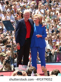 NEW YORK - June 13, 2015: Hillary Clinton, Bill Clinton appear on stage during the Hillary For America campaign launch event at Four Freedoms Park on June 13, 2015 in New York.