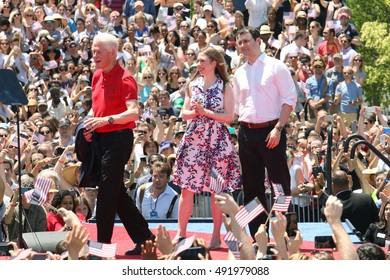 NEW YORK - June 13, 2015: Bill Clinton and Chelsea Clinton appear on stage during the Hillary For America campaign launch event at Four Freedoms Park on June 13, 2015 in New York.