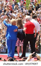 NEW YORK - June 13, 2015: Hillary Clinton, Bill Clinton and Chelsea Clinton appear on stage during the Hillary For America campaign launch event at Four Freedoms Park on June 13, 2015 in New York.
