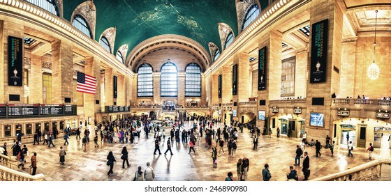 NEW YORK, JUNE 14: Commuters and tourists in the grand central station in June 14, 2013 in New York, panoramic view. It is the largest train station in the world by number of platforms: 44