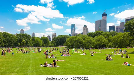 NEW YORK - JUNE 14: People enjoying relaxing outdoors in Central Park on June 14, 2014 in New York. The park is the most visited urban park in the United States with 35 million visitors annually.