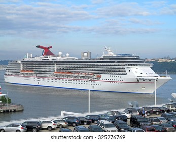 NEW YORK, NEW YORK - June 15, 2012 - The Carnival Miracle sailing alongside New York, New York.