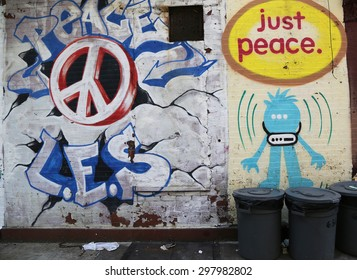 NEW YORK - JUNE 16, 2015: Mural art in Lower East Side in Manhattan. A mural is any piece of artwork painted or applied directly on a wall, ceiling or other large permanent surface