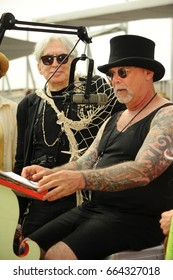 NEW YORK - JUNE 17, 2017: Coney Island USA Artistic Director Dick Zigun ( R) making a speech to King  Neptune Chris Stein (L) at the 35th annual Mermaid Parade on June 17, 2017 in Brooklyn NY