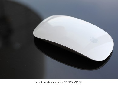 New York - June 20 2010: The Apple White Magic Mouse on the desk. It is the first consumer mouse to have multi-touch capabilities