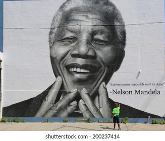 NEW YORK - JUNE 21: Unidentified child in the front of the Nelson Mandela mural in Williamsburg section in Brooklyn on June 21, 2014.