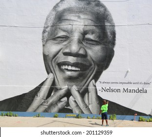 NEW YORK - JUNE 21: Unidentified child in the front of the Nelson Mandela mural in Williamsburg section in Brooklyn on June 21, 2014