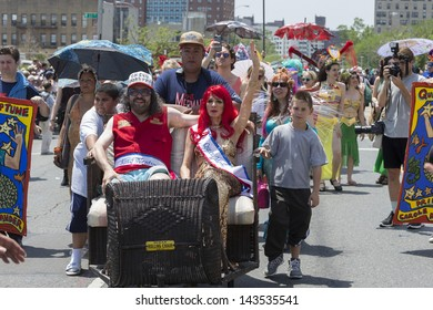 NEW YORK - JUNE 22: Judah Friedlander as King Neptune and Carole Radziwill as Queen Mermaid attend the 2013 Mermaid Parade at Coney Island on June 22, 2013 in Brooklyn, New York