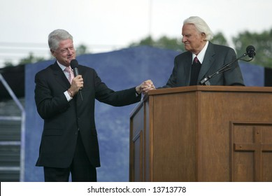 NEW YORK - JUNE 25: Former U.S. President Bill Clinton (L) speaks with Rev. Billy Graham while on stage at the Greater New York Billy Graham Crusade June 25, 2005 in Flushing, New York.