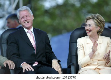 NEW YORK - JUNE 25: Former U.S. President Bill Clinton (L) and his wife, U.S. Senator Hillary Clinton (D-NY), laugh at the Greater New York Billy Graham Crusade June 25, 2005 in Flushing, New York.