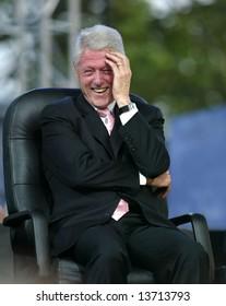 NEW YORK - JUNE 25: Former U.S. President Bill Clinton laughs while attending the Greater New York Billy Graham Crusade June 25, 2005 in Flushing, New York.