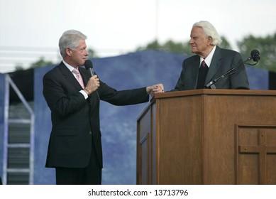 NEW YORK - JUNE 25: Former U.S. President Bill Clinton (L) speaks with Rev. Billy Graham at the Greater New York Billy Graham Crusade June 25, 2005 in Flushing, New York.