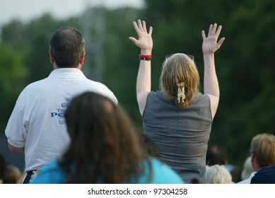 NEW YORK - JUNE 25:  An unidentified woman gestures as she prays at the Greater New York Billy Graham Crusade in Flushing Meadow Corona Park June 25, 2005 in Flushing, NY.