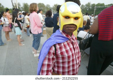 """NEW YORK - JUNE 25:  A young child calling himself """"Bible Boy"""" attends the Greater New York Billy Graham Crusade in Flushing Meadow Corona Park June 25, 2005 in Queens, NY."""