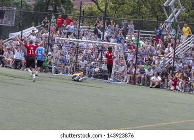 NEW YORK - JUNE 26: Soccer players Stuart Holden; Sammy Amoebi, Massimo Ambrosini play at The Sixth Steve Nash Foundation Showdown at Sarah D. Roosevelt Park on June 26, 2013 in New York City.