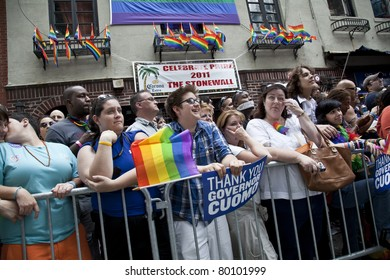 NEW YORK - JUNE 26: Unidentified revelers lined up along the march route at Stonewall bar during Pride march along Fifth Avenue at pride parade on June 26, 2011 in New York City.