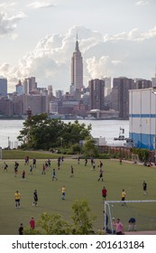 NEW YORK - JUNE 27: Bushwick Inlet Park on June 27th, 2014 in Williamsburg, New York. The Bushwick Inlet Park soccer field development is an all new green park space in Williamsburg Brooklyn.