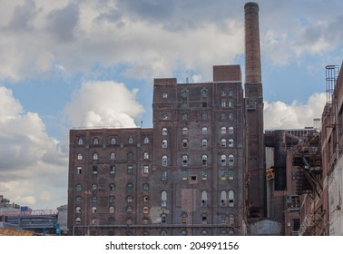 NEW YORK - JUNE 27: The Domino Sugar Factory on June 27th, 2014 in Brooklyn, New York. The Domino Sugar Factory is slated for residential development.