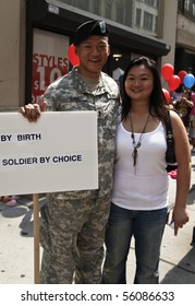 NEW YORK - JUNE 27: Grand Marshal Lieutenant Dan Choi with sister at the 2010 New York City Gay Pride March on the streets of Manhattan on June 27, 2010 in New York City.