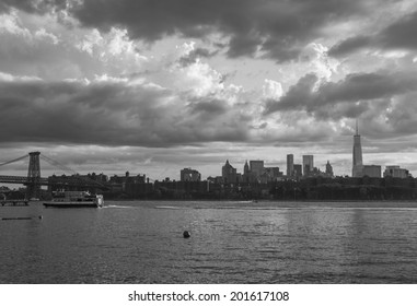 NEW YORK - JUNE 27: Manhattan skyline as seen from Williamsburg on June 27th, 2014 in Brooklyn, New York. Manhattan is the most densely populated of the 5 boroughs.