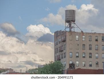 NEW YORK - JUNE 27: Water tower on June 27th, 2014 in Brooklyn, New York. Williamsburg is a neighborhood of 113,000 inhabitants.