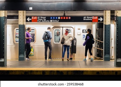 NEW YORK, NEW YORK - JUNE 28, 2013: MTA subway train station platform with people traveling in New York on June 28, 2013. The NYC subway system is one of the oldest in the USA.