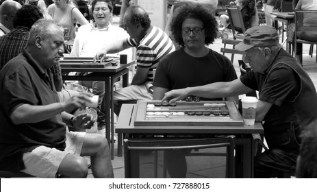 New York - June 28 2016: Backgammon is a popular game in New York parks. All kinds of people play it regularly.