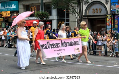 NEW YORK - JUNE 28: Parade goers participate in the NYC LGBT Gay Pride March on June 28, 2009 in New York.