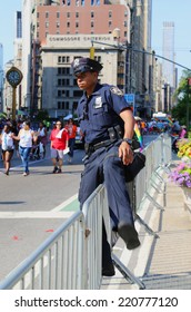 NEW YORK - JUNE 29: NYPD officer during LGBT Pride Parade in NY on June 29, 2014. LGBT pride march takes place during pride week and is the culmination of week long festivities