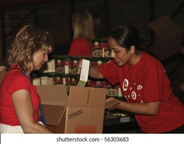 NEW YORK - JUNE 29: Unidentified volunteers help assemble meals at 'Target Party for Good' as part of the 2010 National Conference on Volunteering on Pier 36 South Street on June 29, 2010 in N