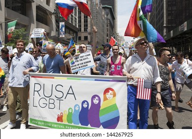 NEW YORK - JUNE 30: Protesters against anti-gay policies of Russian government during annual 43rd Pride Parade on Fifth Avenue in Manhattan on June 30, 2013 in New York City