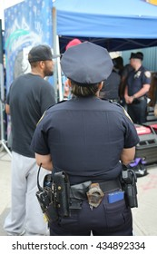 NEW YORK - JUNE 4, 2016: NYPD officer providing security at Hip Hop concert during  Bushwick Collective Block Party in Brooklyn