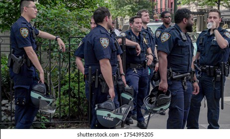 NEW YORK - JUNE 5, 2020: NYPD police officers not wearing masks nor social distancing during COVID-19 pandemic in New York City NYC.