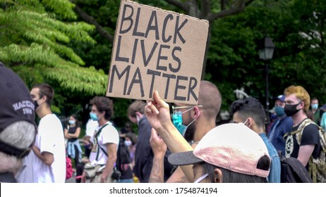 NEW YORK - JUNE 5, 2020: Black Lives Matter sign among diverse group of allies of the BLM movement at peaceful protest for George Floyd, rally in Washington Square Park, New York City, NYC.