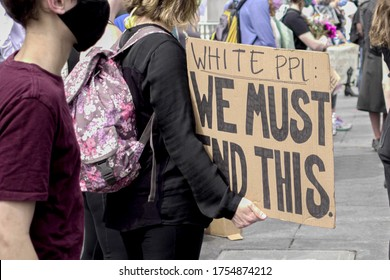 NEW YORK - JUNE 5, 2020: white people we must end this sign from ally of BLM at Black Lives Matter protest for George Floyd, rally in Washington Square Park, New York City, NYC.