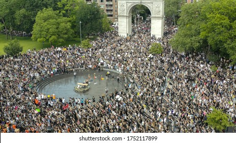 NEW YORK - JUNE 6, 2020: Black Lives Matter rally - demonstration peaceful protest - people protestors crowded in Washington Square Park New York City NYC.
